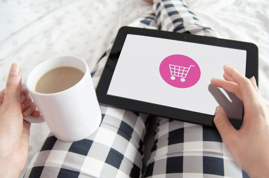 Woman with tablet and there is a ecommerce logo