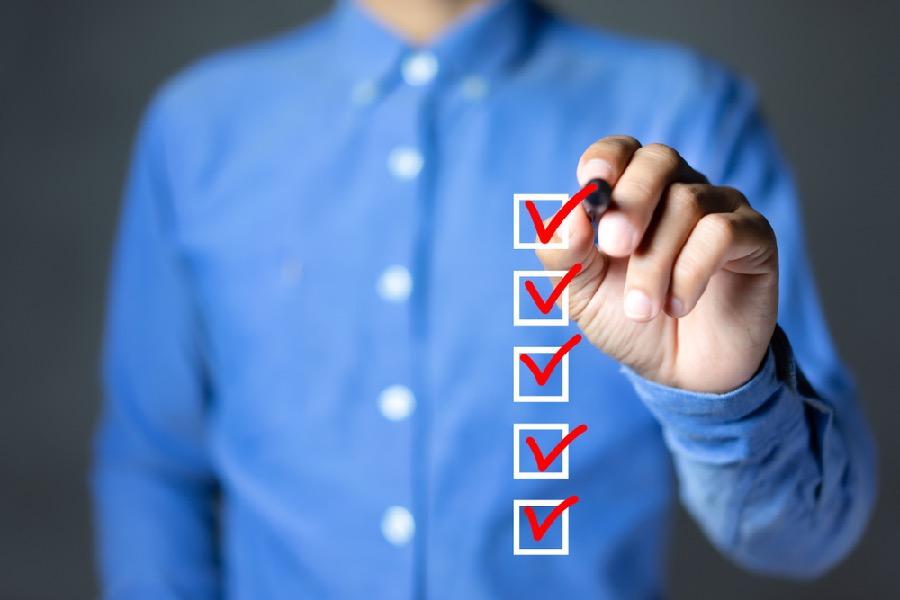 Man checks items in checklist